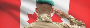 Solder in front of Canadian Flag